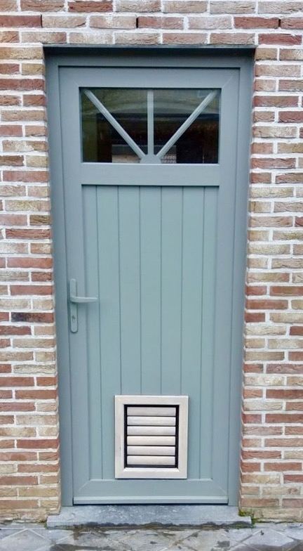 Dog Flap | Dog Door | Jake (Medium) Grey wooden dog flap for medium sized dogs installed in a green door | © Tomsgates