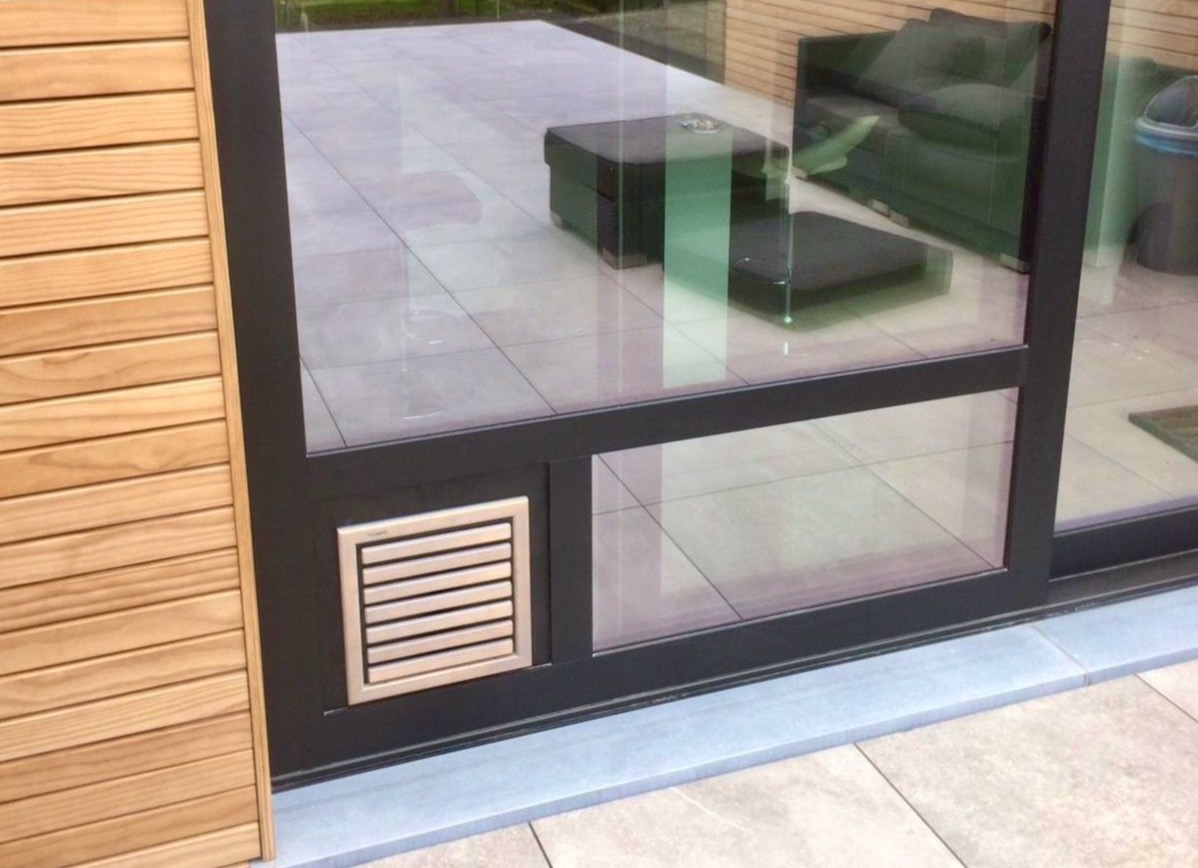 Dog Flap | Dog Door | Custom made natural wooden dog flap installed in fixed panel of a sliding door | © Tomsgates