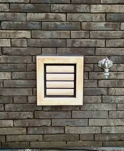 Dog Flap | Cat Flap | Dog Door | Cat Door | Nipper (Small) Grey wooden dog flap for a Pug and cat door installed in an anthracite grey brick wall | © Tomsgates