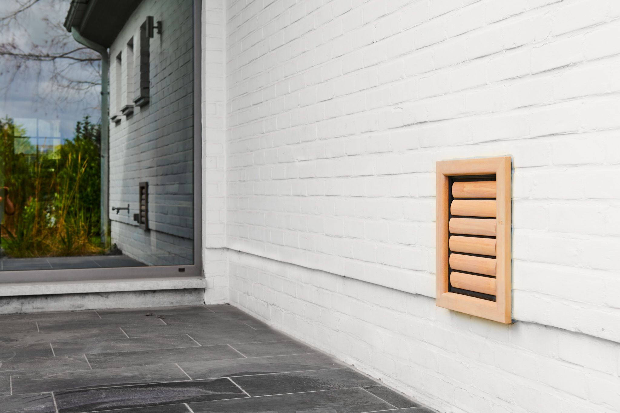 Dog Flap | Dog Door | Jake (M) Natural wooden dog flap installed in white painted brick wall | © Tomsgates