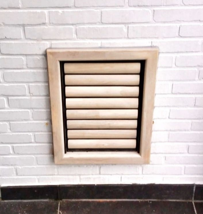 Dog Flap | Dog Door | Beethoven (Extra Large) Natural wooden dog flap installed in a white brick cavity wall  | © Tomsgates